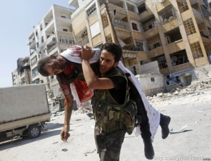 Free Syrian Army rebel trying to save his friend's life.