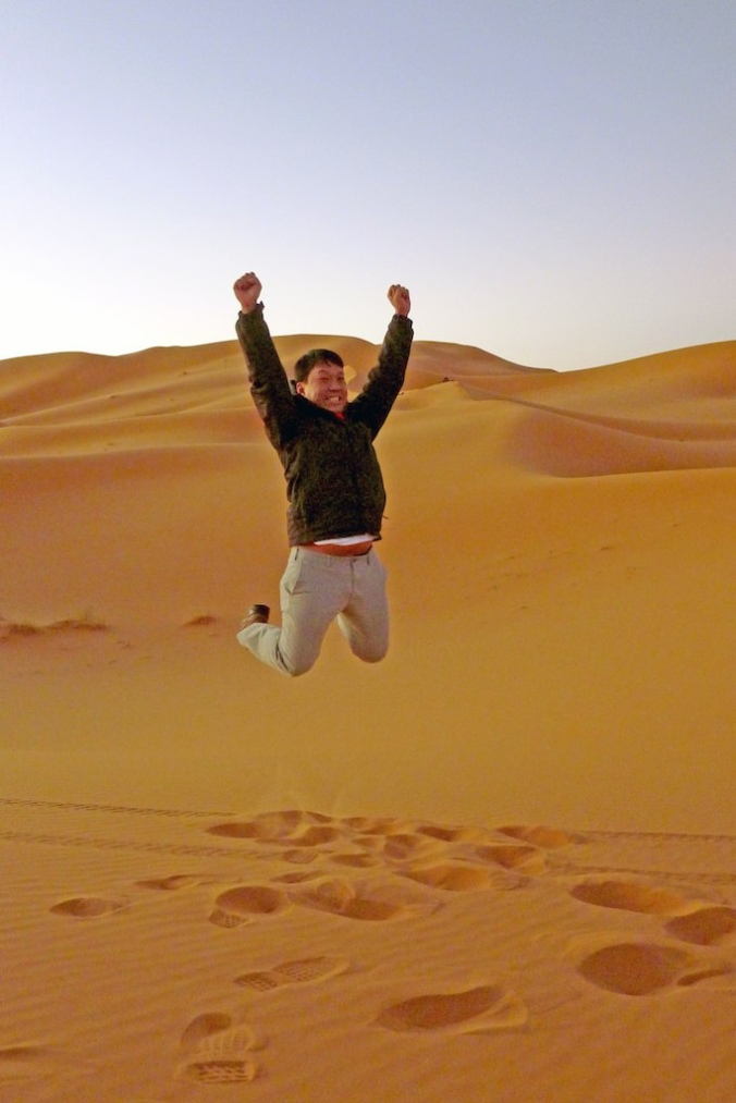 Derek jumps for joy in the Merzouga Dunes