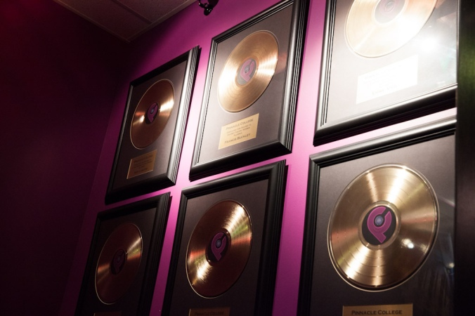 Gold records on the wall.
